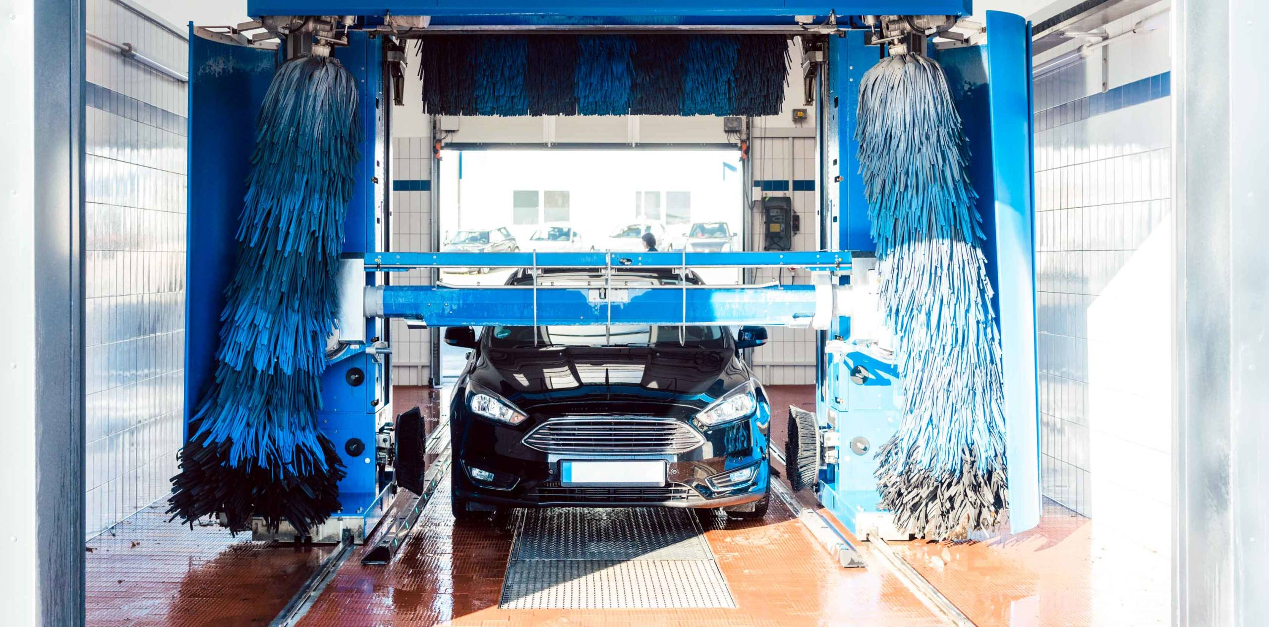 Car going through a car wash illustrating the benefits of softer water on automobiles.