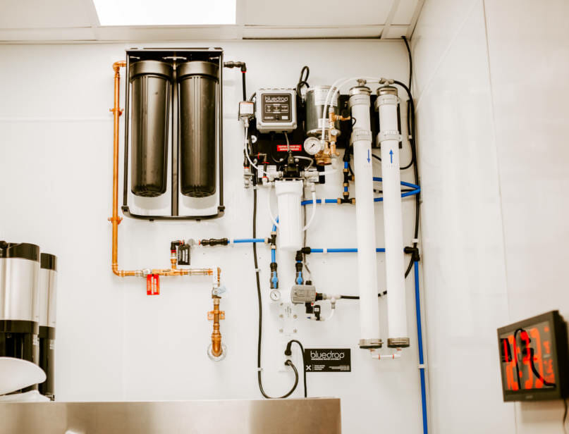 A food service filtration system mounted on a wall.
