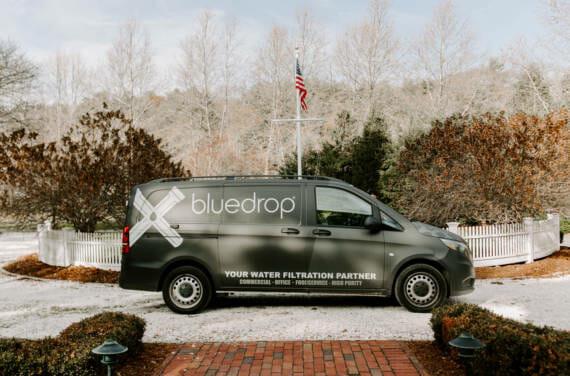 A bluedrop water branded van.