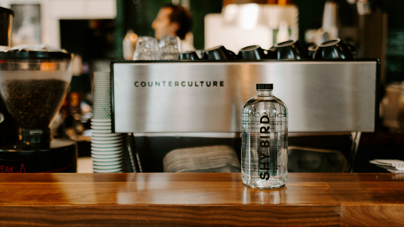 A custom branded bottle on a counter at a restaurant.
