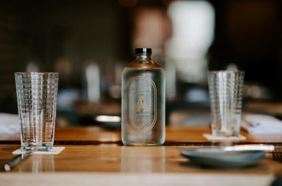 A bottle sitting on a restaurant table at Alcove in Boston.