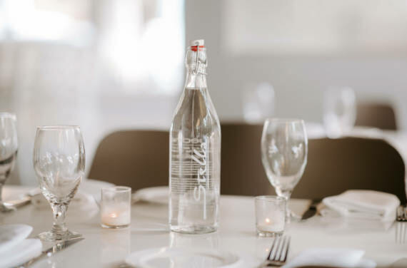 A custom branded bottle sitting on a restaurant table at Stella.